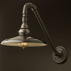 Angled Plumbing Pipe Wall Shade Lamp with 45° elbows. This is a custom design made from steel pipe and cast fittings.
