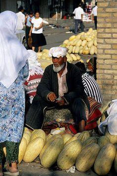 Uzbekistan, Samarkand. Melon seller at the main market
