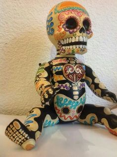 'DAY OF THE DEAD' doll... I could paint a few thrift store dolls to use as party decor.