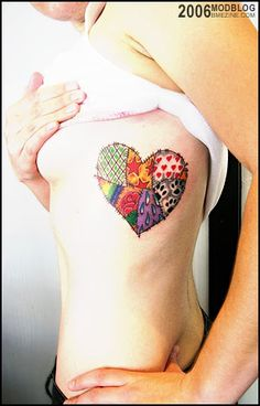 I love this patched heart tattoo! It's a great way to integrate friends and family and pets that make up your heart. :)