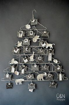 Everywhere & nowhere: Wire – Advent calendar made of wire hangers and when I tamed the wild animals (from a book ; Unique Christmas Trees, Noel Christmas, All Things Christmas, Beautiful Christmas, Advent Calenders, Diy Advent Calendar, Christmas Projects, Christmas Crafts, Christmas Ideas