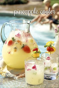Beverage idea: strawberry pineapple cooler, with frozen edible flowers and mint sprigs in ice cubes.