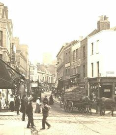 Two views of Woolwich High Street, c.1905: 1. Looking west from the junction with Hare Street and Nile Street (Ferry Approach). This part of the High Street looks quite different today, the buildings on the north (right) side of the road have been demolished and the very narrow road shown here is now a dual carriageway. It is no longer possible to see the tower of St. Mary Magdalen's Church as it is masked by the former Granada cinema. 2. Looking east from the intersection with Powis Street.
