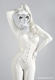 Latex model in white suite with bodysuit and mask