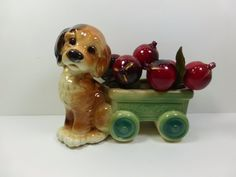 A sweet vintage Royal Copley Dog and Flyer Planter circa 1950s. This Vintage Royal Copley Planter has a cute Brown Dog with a Radio Flyer Wagon as
