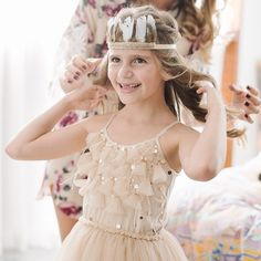 Another glowing flower girl prepping herself for the big day, featuring the Serenity Tutu Dress in Nougat and Firefly Headband. Just adorable @sara_j_francis, shot by @therarenegatives. #tutudumonde #tutucute #flowergirl #wedding #kidsfashion