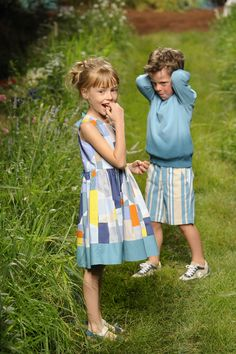 Interesting patch pattern print dress at Il Gufo kids fashion catwalk for spring 2016
