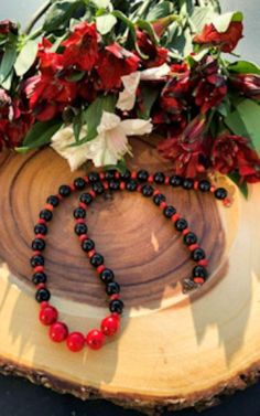 Handmade Coral, Black Onyx and Howlite Necklace Red coral has uplifting energy that will leave you feeling rejuvenated and passionate about life. It evokes passion, romance, and strength. It encourages optimism romantic love. Focus On Your Goals, Clear Your Mind, Emotional Pain, Protection Stones, Romantic Love, Red Coral, Handmade Sterling Silver, Black Magic, Gemstone Necklace