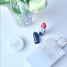 A red lip, a spritz of Burberry & a smoothing of Wonder Balm...