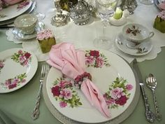 """I created a new tablescape for a Mother's Day Tea. The 90"""" round soft green tablecloth was $2.49 TS find. The silvered glass teapot set is from Ross. The Rose plates are also from Ross. The teacups are assorted TS and inherited items. The doilies were from my DGM. The 2 lifts were TS finds. The..."""