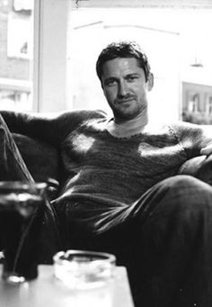 Gerard Butler... I'd come hang out on that couch with you. You hot hunk o' man meat you. Mmmm