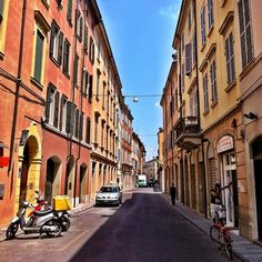A colorful street in Modena. What a gorgeous town! - Instagram by @Keith Jenkins