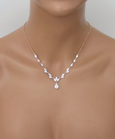 Sparkling rose gold finish necklace and earring set made of marquise cuts cubic zirconias and a single tear drop cut that dangles in the center with matching earrings. This beautiful set is both lovely and radiant, the perfect accessory set for any formal event that is in need of a
