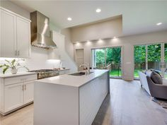 Beautiful kitchen equipped with quartz countertops with waterfall side edges that go all the way to the floor!