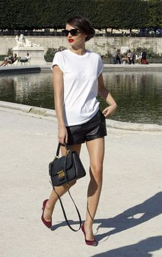 Miranda Kerr looking fab in leather shorts and a plain white tee