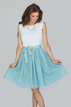 In a beautiful tulle finish, this mint skirt is full of soft layers. Just the perfect fit and flare shape with a gorgeous fullness and a matching bow for that final touch of femininity. 100% polyester