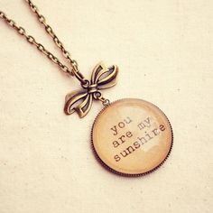 "Cute Handmade Necklace with ""You are my Sunshine"" Pendant. I love this because when I was little this was my favorite song."