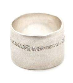 For a bolder look with a touch of glam. This 15mm ultra-wide band sheds an…