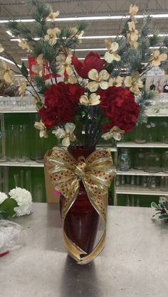 Red and gold Christmas. Big bow. Hydrangeas are my fave.
