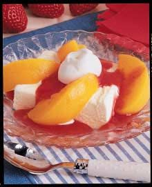 "Strawberry Peach Melba Recipe -I get ""oohs"" and ""aahs"" when setting out this cool, fruity dessert. It combines my three all-time favorites-peaches, strawberries and ice cream. It's so simple I can assemble it for company after we all finish the main course."
