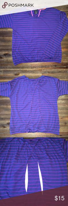 Oakley Women's Athletic Shirt - Large Brand: Oakley Gender: Women's  Item: Athletic Shirt Color:  Purple with Pink Stripes Size: Women's Large Neckline:  Scoop Neck Sleeve Length: Long Sleeve Additional Description:  Cut Outs on Back, Elastic at Waist and Wrists Materials:   65% Poly, 35% Rayon Under Arm to Under Arm Measurement: 21 Inches  Length:  23.5 Inches  Condition:  Great Condition! Oakley Tops