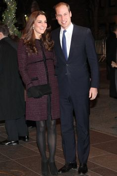 Prince William and Catherine, Duchess of Cambridge, aka Kate Middleton, arrive at their hotel in New York City. Kate is wearing a bespoke coat by Seraphine Maternity, Muse clutch from Stuart Weitzman via Russell & Bromley, and wearing her Cornelia James merino jersey wool gloves, and a pair of black suede booties. 12/07/14