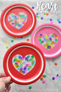 This heart suncatcher craft is simple colorful and perfect for an afternoon Valentine's Day craft. All you need is paper plates color confetti and clear contact paper to make this colorful heart suncatcher craft for Valentine's Day. This heart suncatche Valentine's Day Crafts For Kids, Valentine Crafts For Kids, Mothers Day Crafts, Toddler Crafts, Preschool Crafts, Holiday Crafts, Valentine Theme, Valentines Art, Suncatcher