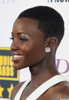 Lupita at the 2014 Critics' Choice Awards. Loving the hair again - fake widow's peak and all!