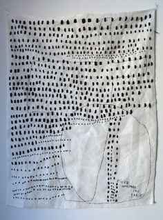 Rieko Koga uses negative space in this hand stitched piece on linen. See her text work and works on found cardboard boxes.