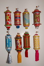 Christmas ornaments made with wine corks, buttons, decorative papers, beads, and tassels.