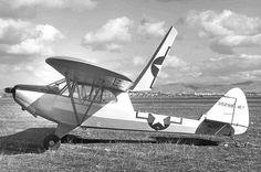 1944- Flight crews unload U S  Navy Piper AE-1