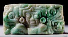 Maya Jade. Pendant. Portrait head in maw of serpent. Profiles of serpent heads with skull emerging.