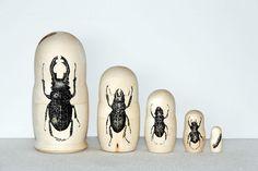 black insect, matryoshka wood by raul gutierrez