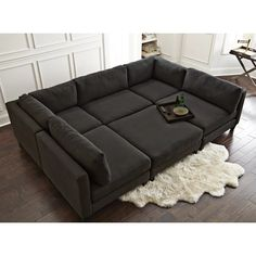Their Chelsea Reversible Sleeper Sectional with Ottoman is the piece that started it all! It's the perfect sofa to get lost in for hours while consuming copious amounts of movies and pizza. U Couch, Sectional Bed, Corner Sectional, Sleeper Sofa, Pit Sofa, Sofa Uk, Leather Sectional, Design Furniture, Sofa Furniture