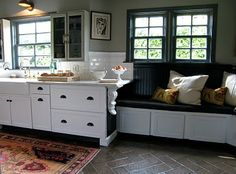 Tia Zoldan kitchen with banquette. kitchen table removed for photo. How to use a small space