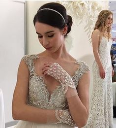 Love this shot! #hair #makeup by us #Repost @watterswtoo  ・・・  These delicate gloves (Handbeaded by our designers) were named as one of the top trends by @cosmobride. See more on our Facebook page. Photo by @martha_weddings.    #Watters #AzaleaGown #Fall2016 #weddingdress #marthastewartweddings #cosmobride @coutureshow