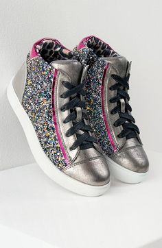 Glitter high-top sneakers!!! Glittery sidewalls and metallic faux leather give this spunky high-top sneaker loads of personality. A padded tongue and chunky bumper sole make it comfortable enough for her to play in all day long. Need these for back-to-school shopping.