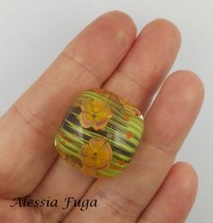 Water flowers focal lampwork glass bead in purple, green, coral and yellow di alessiafuga su Etsy