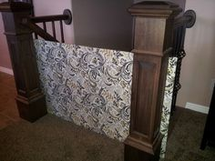 "Baby Gate...Created with just a 1/2"" piece of particle board and covered with upholstery fabric.  Slides right between the Banister and poles...NO HOLES or damage to wood!"