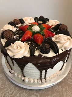 Tres leches cake filled with flan napolitano. Mocha whipped icing, topped with Ferrero Rocher, Oreos and strawberries