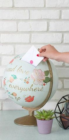 Need a fun and creative idea on how to store your wedding cards? If you love to travel, try out this clever Globe Holder featuring a slit cut into it. Click on the link to see a step-by-step tutorial on how to make this unique idea.