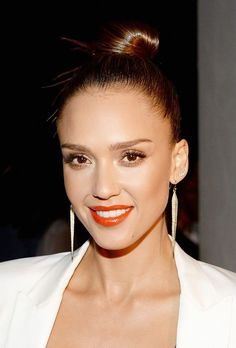 Can't get enough of Jessica Alba's top knot, glowing skin and red-orange lip