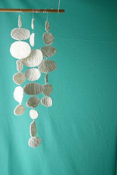 clouds. vintage doilies sewn onto felt & then cut freehand.