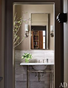 Marble from Ann Sacks lines Filipowski's bath, which has a Waterworks sink and fittings and is painted in Drab by Farrow & Ball.