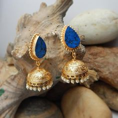 https://www.cooliyo.com/product/105741/ethnic-look-turquoise-stone-blue-jhumki-earrings/
