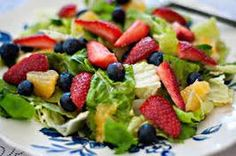 Strawberry Poppyseed Salad... This was very yummy, Steven really enjoyed it as well! I probably could have halved the dressing. Made ckn breast in Larry's garlic marinade on stove top- delish
