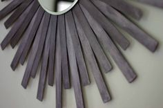 This is an even cheaper version of the DIY Sunburst Mirror; made from paint stirs!