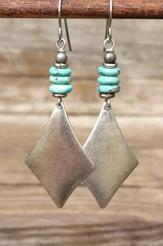 Silver geometric boho style earrings with turquoise magnesite accent. Light-weight, diamond shaped antiqued silver with small turquoise magnesite accent stones. Great everyday earrings and a perfect gift idea for anyone who loves bohemian styled silver jewelry. Product overview: *