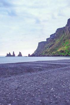 A strange and beautiful beach in Iceland. The Black Sand Beach near Vik, Iceland