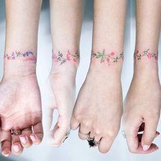Flower bracelet tattoo. Tattoo artist: Sol Tattoo